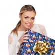 Stock Photo: Womholds gift wrapped in christmas paper