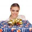 Woman holds a gift wrapped in christmas paper — Foto Stock