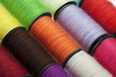 Background made of colorful sewing threads — Stockfoto