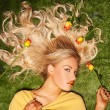 Seductive blond with her hair covered in roses — Stock Photo #36574019