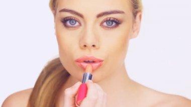 Gorgeous woman blowing a lipstick kiss — Stock Video