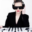 Beautiful sexy disc jockey at her deck — Stock Photo #37178233