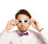 Serious young man wearing 3d glasses — Stock Photo