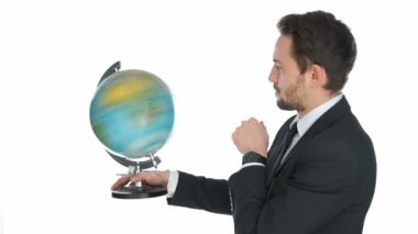 Businessman spinning a globe — Stock Video