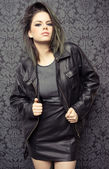 Sexy trendy young woman in leather — Stock Photo