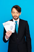 Young business man showing playing cards — Photo