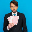 Young business man showing playing cards — Stock Photo #44107699