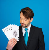 Young business man showing playing cards - — Photo