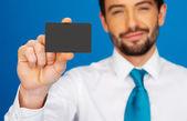 Businessman holding blank businesscard — Stock Photo