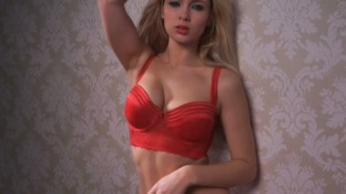 Sexy blonde woman wearing red lingerie camera — Stock Video