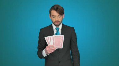 Handsome businessman holding playing cards — Stock Video