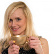 Beautiful woman drinking from a golden cup — Stock Photo #44944587