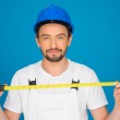 Smiling workman holding a tape measure — Stock Photo #45550451
