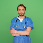 Confident friendly young male doctor or nurse — Stock Photo