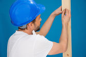 Carpenter or joiner marking a measurement — Stock Photo