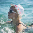 Beautiful blonde woman swimming in the sea — Stock Photo #46776423