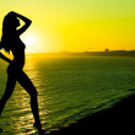 Sunset, sexy nude woman silhouette — Stock Photo #47175797