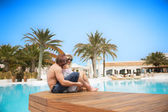 Cute couple kissing near the pool — Stock Photo
