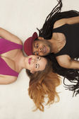 Cute young mixed couple on the floor — Stock Photo