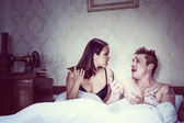 Young couple arguing in bed — Stok fotoğraf