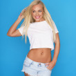 Trendy young blond woman in denim shorts — Stock Photo #48862825