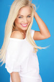 Beautiful young blond with a vivacious smile — Stock Photo