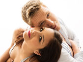 Sweet couple smiling with cheeks touching — Foto Stock