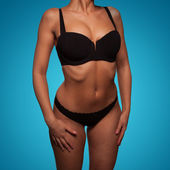 Torso of a slim woman wearing sexy black underwear — Stock Photo