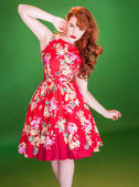 Red haired woman wearing a red summer dress — Stock Photo