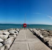 Deserted stone pier or seawall — Stock Photo