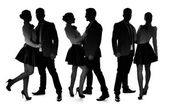Three silhouettes of a romantic loving couple — Stock Photo