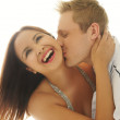 Laughing woman being kissed by her lover — Stock Photo #49765177