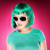 Trendy beautiful young woman in sunglasses — Stock Photo