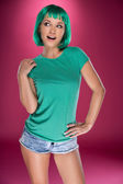 Sexy young woman with a green hairstyle — Stock Photo