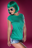Cute slender young woman with green hair — Stock Photo