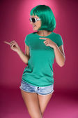 Cute slender young woman with green wig — Stockfoto