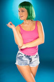 Cute slender young woman with green wig — Foto Stock