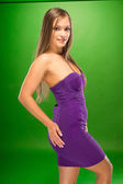 Young Woman in Sexy Violet Dress Side View Pose — Stock Photo