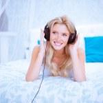 Quiet woman enjoying some music in her bedroom — Stock Photo #50908811