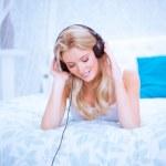 Quiet woman enjoying some music in her bedroom — Stock Photo #50908813
