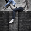 Young Couple Posing on Concrete Wall — Stock Photo #50911293