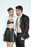 Sexy Couple in Fashion Attire Flaunting Bodies — Stock Photo
