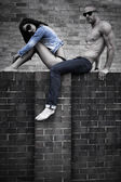 Young Couple Posing on Concrete Wall — Stock Photo