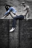 Young Couple Posing on Concrete Wall — Stok fotoğraf
