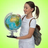 Smiling young schoolgirl with a globe — Stock Photo