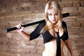 The girl with a baseball bat. — Stock Photo