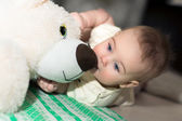 Baby and teddy bear. — Stock Photo