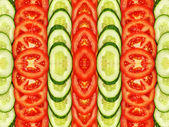 Sliced tomatoes and cucumbers.Symmetrical background. — Stock Photo