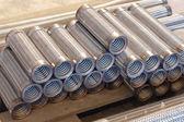 Heap of flexible metal hose. — Stock Photo