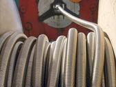 Flexible metal hose coil. — Stock Photo